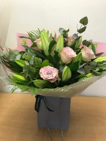 Rose and lily hand tied bouquet